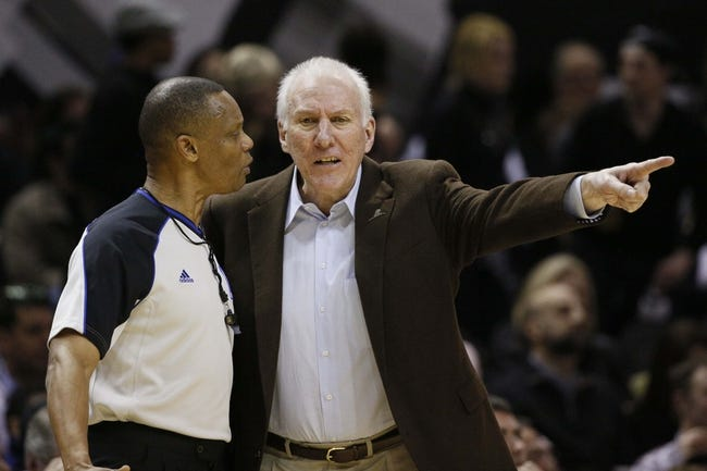 Mar 8, 2014; San Antonio, TX, USA; San Antonio Spurs head coach Gregg Popovich argues a call with referee Michael Smith during the first half against the Orlando Magic at AT&T Center. Mandatory Credit: Soobum Im-USA TODAY Sports