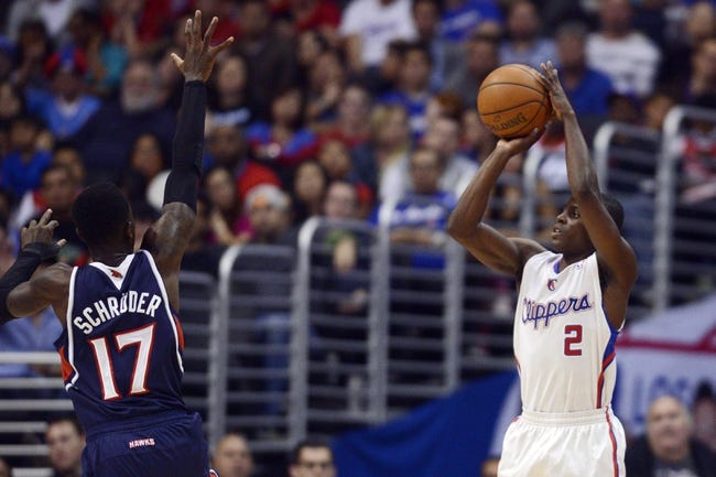 Mar 8, 2014; Los Angeles, CA, USA; Los Angeles Clippers guard Darren Collison (2) goes up for a shot defended by Atlanta Hawks guard Dennis Schroder (17) during the second quarter at Staples Center. Mandatory Credit: Kelvin Kuo-USA TODAY Sports