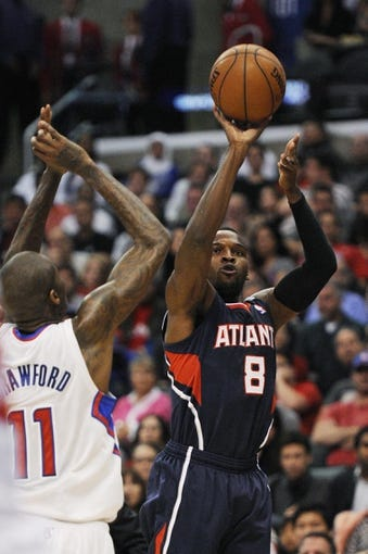 Mar 8, 2014; Los Angeles, CA, USA; Atlanta Hawks guard Shelvin Mack (8) goes up for a shot defended by Los Angeles Clippers guard Jamal Crawford (11) during the second quarter at Staples Center. Mandatory Credit: Kelvin Kuo-USA TODAY Sports