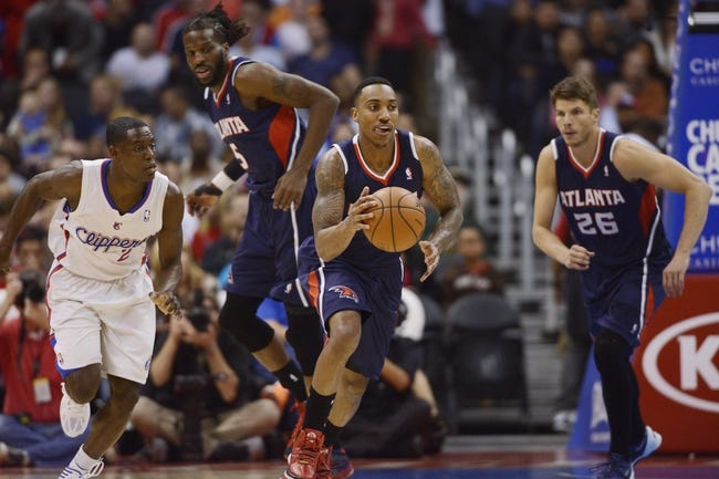 Mar 8, 2014; Los Angeles, CA, USA; Atlanta Hawks guard Jeff Teague (0) runs the ball up the court during the first quarter at Staples Center. Mandatory Credit: Kelvin Kuo-USA TODAY Sports