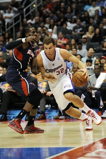Mar 8, 2014; Los Angeles, CA, USA; Los Angeles Clippers forward Blake Griffin (32) moves the ball defended by Atlanta Hawks forward DeMarre Carroll (5) during the fourth quarter at Staples Center. The Los Angeles Clippers defeated the Atlanta Hawks 109-108. Mandatory Credit: Kelvin Kuo-USA TODAY Sports