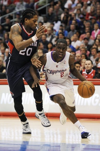 Mar 8, 2014; Los Angeles, CA, USA; Los Angeles Clippers guard Darren Collison (2) moves the ball defended by Atlanta Hawks forward Cartier Martin (20) during the fourth quarter at Staples Center. The Los Angeles Clippers defeated the Atlanta Hawks 109-108. Mandatory Credit: Kelvin Kuo-USA TODAY Sports