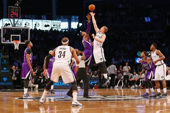 Mar 9, 2014; Brooklyn, NY, USA;  Sacramento Kings power forward Jason Thompson (34) and Brooklyn Nets power forward Mason Plumlee (1) tip off at Barclays Center. Mandatory Credit: Anthony Gruppuso-USA TODAY Sports