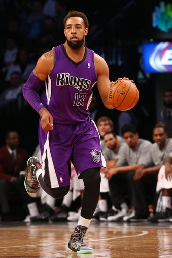 Mar 9, 2014; Brooklyn, NY, USA;  Sacramento Kings power forward Derrick Williams (13) advances the ball during the second quarter against the Brooklyn Nets at Barclays Center. Mandatory Credit: Anthony Gruppuso-USA TODAY Sports