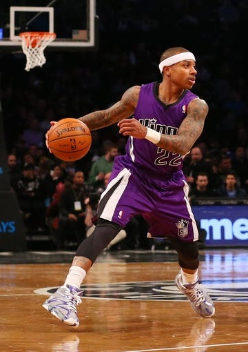 Mar 9, 2014; Brooklyn, NY, USA;  Sacramento Kings point guard Isaiah Thomas (22) drives the ball during the first quarter against the Brooklyn Nets at Barclays Center. Mandatory Credit: Anthony Gruppuso-USA TODAY Sports