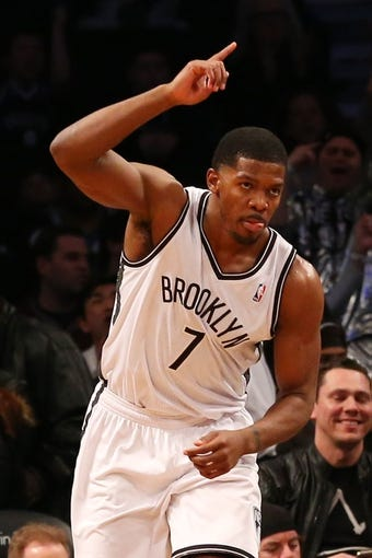 Mar 9, 2014; Brooklyn, NY, USA;  Brooklyn Nets shooting guard Joe Johnson (7) gestures after scoring during the first quarter against the Sacramento Kings at Barclays Center. Mandatory Credit: Anthony Gruppuso-USA TODAY Sports