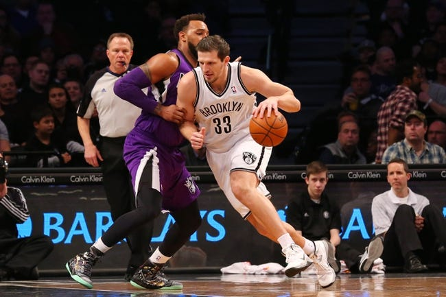 Mar 9, 2014; Brooklyn, NY, USA;  Brooklyn Nets power forward Mirza Teletovic (33) drives on Sacramento Kings defense during the second quarter at Barclays Center. Mandatory Credit: Anthony Gruppuso-USA TODAY Sports