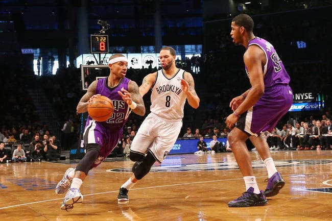 Mar 9, 2014; Brooklyn, NY, USA;  Sacramento Kings point guard Isaiah Thomas (22) drives past Brooklyn Nets point guard Deron Williams (8) during the first quarter at Barclays Center. Mandatory Credit: Anthony Gruppuso-USA TODAY Sports