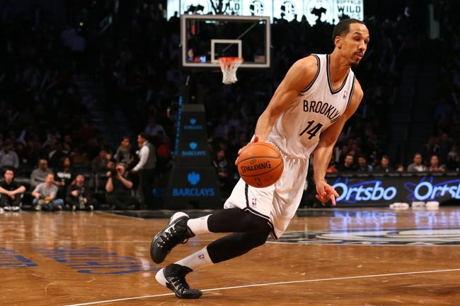 Mar 9, 2014; Brooklyn, NY, USA;  Brooklyn Nets point guard Shaun Livingston (14) drives to the net during the third quarteragainst the Sacramento Kings at Barclays Center. Brooklyn Nets won 104-89.  Mandatory Credit: Anthony Gruppuso-USA TODAY Sports
