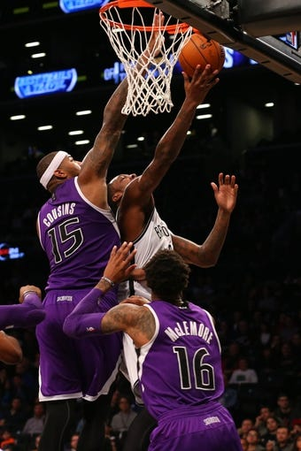 Mar 9, 2014; Brooklyn, NY, USA;  Brooklyn Nets center Andray Blatche (0) at the net as Sacramento Kings center DeMarcus Cousins (15) defends during the third quarter at Barclays Center. Brooklyn Nets won 104-89.  Mandatory Credit: Anthony Gruppuso-USA TODAY Sports