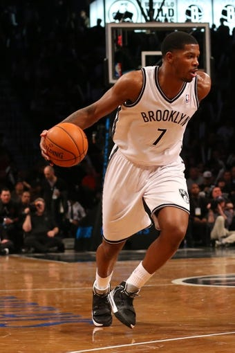 Mar 9, 2014; Brooklyn, NY, USA;  Brooklyn Nets shooting guard Joe Johnson (7) advances the ball during the third quarter against the Sacramento Kings at Barclays Center. Brooklyn Nets won 104-89.  Mandatory Credit: Anthony Gruppuso-USA TODAY Sports