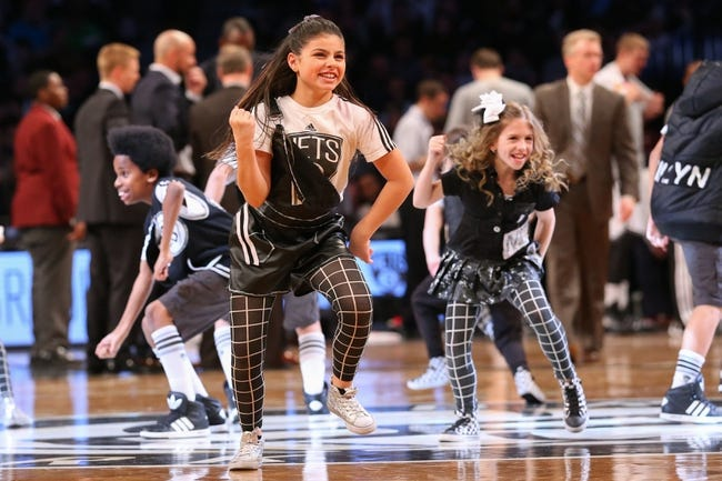 Mar 9, 2014; Brooklyn, NY, USA;   Brooklyn Nets kids dance team performs during the game against the Sacramento Kings at Barclays Center. Brooklyn Nets won 104-89.  Mandatory Credit: Anthony Gruppuso-USA TODAY Sports
