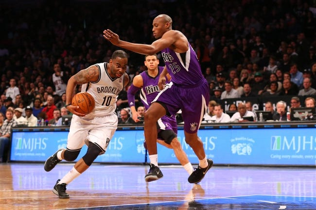 Mar 9, 2014; Brooklyn, NY, USA;  Brooklyn Nets shooting guard Marcus Thornton (10) drives past Sacramento Kings small forward Travis Outlaw (25) during the fourth quarter at Barclays Center. Brooklyn Nets won 104-89.  Mandatory Credit: Anthony Gruppuso-USA TODAY Sports