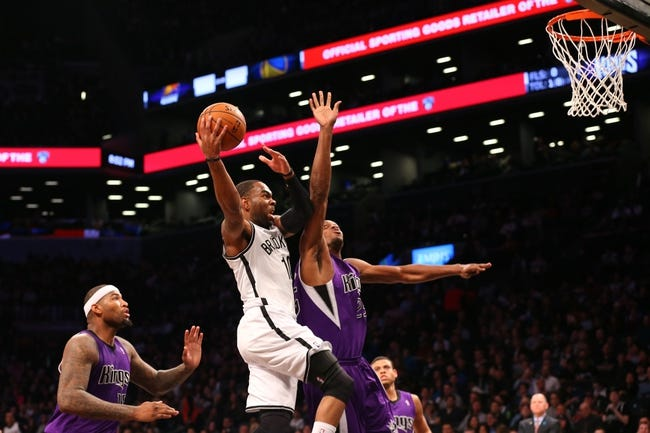Mar 9, 2014; Brooklyn, NY, USA; Brooklyn Nets shooting guard Marcus Thornton (10) drives up past Sacramento Kings small forward Travis Outlaw (25) during the fourth quarter at Barclays Center. Brooklyn Nets won 104-89.  Mandatory Credit: Anthony Gruppuso-USA TODAY Sports