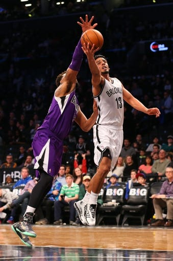 Mar 9, 2014; Brooklyn, NY, USA;  Sacramento Kings center Aaron Gray (33) fouls Brooklyn Nets point guard Jorge Gutierrez (13) during the fourth quarter at Barclays Center. Brooklyn Nets won 104-89.  Mandatory Credit: Anthony Gruppuso-USA TODAY Sports