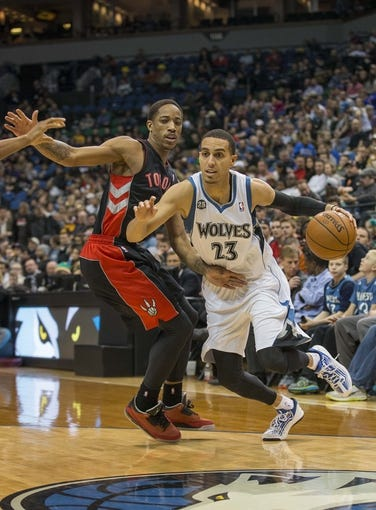 Mar 9, 2014; Minneapolis, MN, USA; Minnesota Timberwolves shooting guard Kevin Martin (23) drives to the basket past Toronto Raptors shooting guard DeMar DeRozan (10) in the second half at Target Center. The Raptors won 111-104. Mandatory Credit: Jesse Johnson-USA TODAY Sports