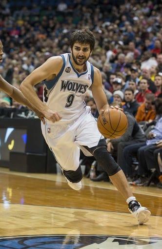 Mar 9, 2014; Minneapolis, MN, USA; Minnesota Timberwolves point guard Ricky Rubio (9) drives to the basket in the second half against the Toronto Raptors at Target Center. The Raptors won 111-104. Mandatory Credit: Jesse Johnson-USA TODAY Sports