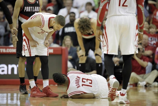 Mar 9, 2014; Houston, TX, USA; Houston Rockets small forward Chandler Parsons (25) speaks to shooting guard James Harden (13) during the overtime period against the Portland Trail Blazers at Toyota Center. Mandatory Credit: Andrew Richardson-USA TODAY Sports