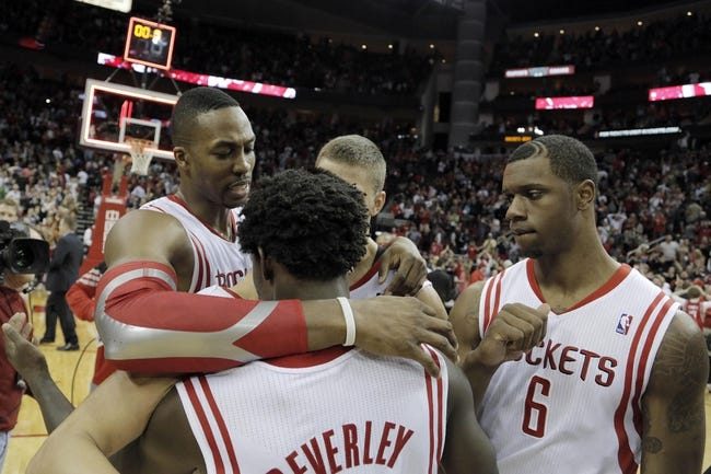 Mar 9, 2014; Houston, TX, USA; Houston Rockets center Dwight Howard (12), point guard Patrick Beverley (2), and power forward Terrence Jones (6) celebrate following the end of overtime against the Portland Trail Blazers at Toyota Center. Mandatory Credit: Andrew Richardson-USA TODAY Sports