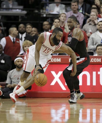 Mar 9, 2014; Houston, TX, USA; Houston Rockets shooting guard James Harden (13) drives to the basket against Portland Trail Blazers shooting guard Wesley Matthews (2) during the fourth quarter at Toyota Center. Mandatory Credit: Andrew Richardson-USA TODAY Sports