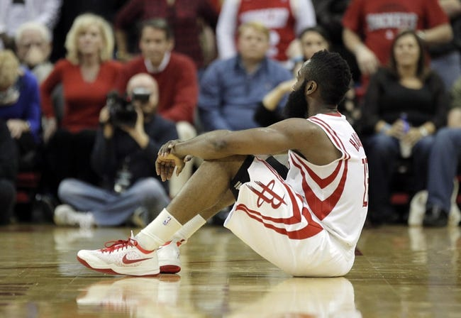 Mar 9, 2014; Houston, TX, USA; Houston Rockets shooting guard James Harden (13) sits on the court in reaction to a play during the fourth quarter against the Portland Trail Blazers at Toyota Center. Mandatory Credit: Andrew Richardson-USA TODAY Sports