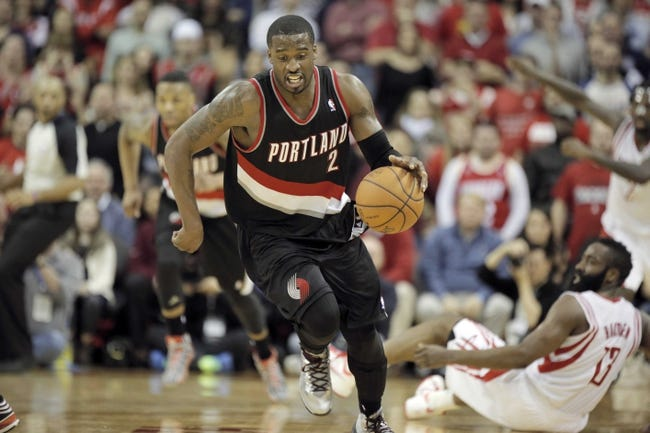 Mar 9, 2014; Houston, TX, USA; Portland Trail Blazers shooting guard Wesley Matthews (2) steals the ball from Houston Rockets shooting guard James Harden (13) during the fourth quarter at Toyota Center. Mandatory Credit: Andrew Richardson-USA TODAY Sports