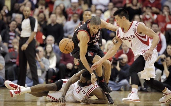 Mar 9, 2014; Houston, TX, USA; Houston Rockets shooting guard James Harden (13), Portland Trail Blazers small forward Nicolas Batum (88) and Rockets point guard Jeremy Lin (7) collide as they chase a loose ball during the fourth quarter at Toyota Center. Mandatory Credit: Andrew Richardson-USA TODAY Sports