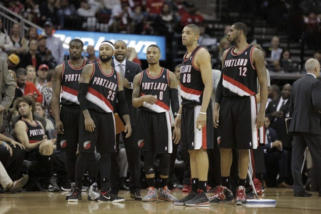 Mar 9, 2014; Houston, TX, USA; the Portland Trail Blazers stand together during a timeout during the fourth quarter against the Houston Rockets at Toyota Center. Mandatory Credit: Andrew Richardson-USA TODAY Sports