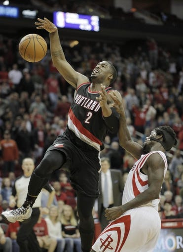 Mar 9, 2014; Houston, TX, USA; Portland Trail Blazers shooting guard Wesley Matthews (2) is fouled by Houston Rockets point guard Patrick Beverley (2) during the overtime period at Toyota Center. Mandatory Credit: Andrew Richardson-USA TODAY Sports