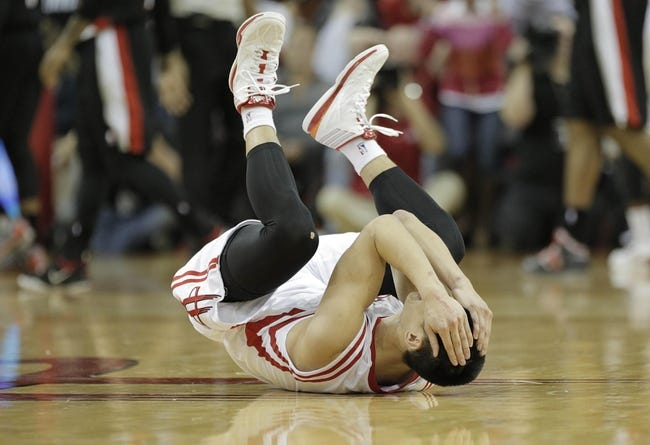 Mar 9, 2014; Houston, TX, USA; Houston Rockets point guard Jeremy Lin (7) reacts to a play during the fourth quarter against the Portland Trail Blazers at Toyota Center. Mandatory Credit: Andrew Richardson-USA TODAY Sports