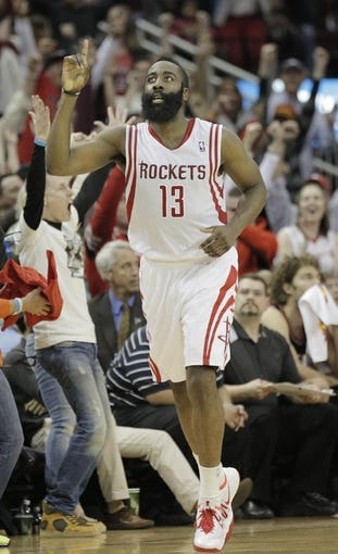 Mar 9, 2014; Houston, TX, USA; Houston Rockets shooting guard James Harden (13) reacts after making a three point shot during the fourth quarter against the Portland Trail Blazers at Toyota Center. Mandatory Credit: Andrew Richardson-USA TODAY Sports