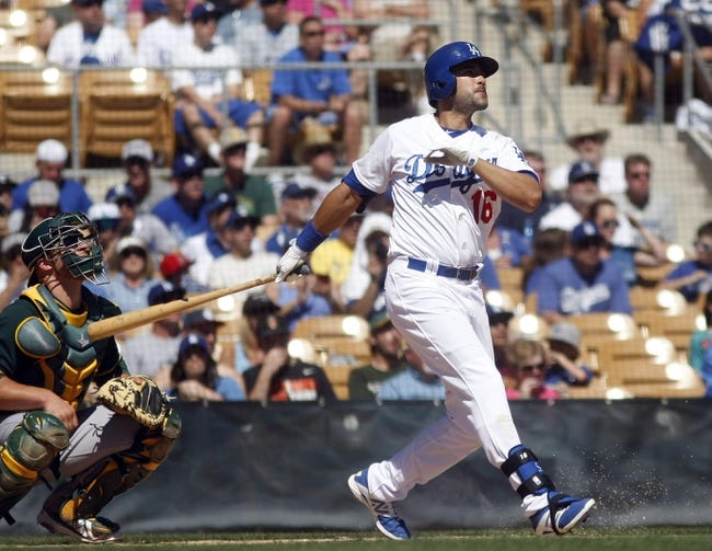 Mar 10, 2014; Phoenix, AZ, USA; Los Angeles Dodgers center fielder Andre Ethier (16) hits a three run home run in the first inning against the Oakland Athletics at Camelback Ranch. Mandatory Credit: Rick Scuteri-USA TODAY Sports