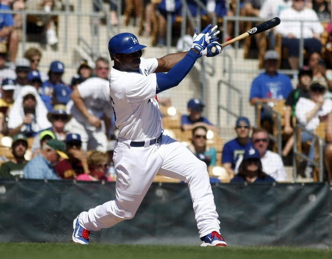 Mar 10, 2014; Phoenix, AZ, USA; Los Angeles Dodgers right fielder Yasiel Puig (66) hits in the second inning against the Oakland Athletics at Camelback Ranch. Mandatory Credit: Rick Scuteri-USA TODAY Sports
