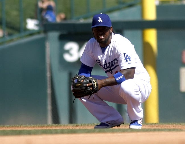Mar 10, 2014; Phoenix, AZ, USA; Los Angeles Dodgers shortstop Hanley Ramirez (13) during the fourth inning against the Oakland Athletics at Camelback Ranch. Mandatory Credit: Rick Scuteri-USA TODAY Sports