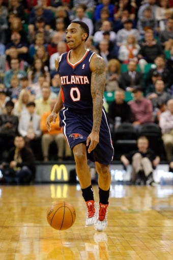 Mar 10, 2014; Salt Lake City, UT, USA; Atlanta Hawks point guard Jeff Teague (0) brings the ball up the court against the Utah Jazz during the second quarter at EnergySolutions Arena. Mandatory Credit: Chris Nicoll-USA TODAY Sports