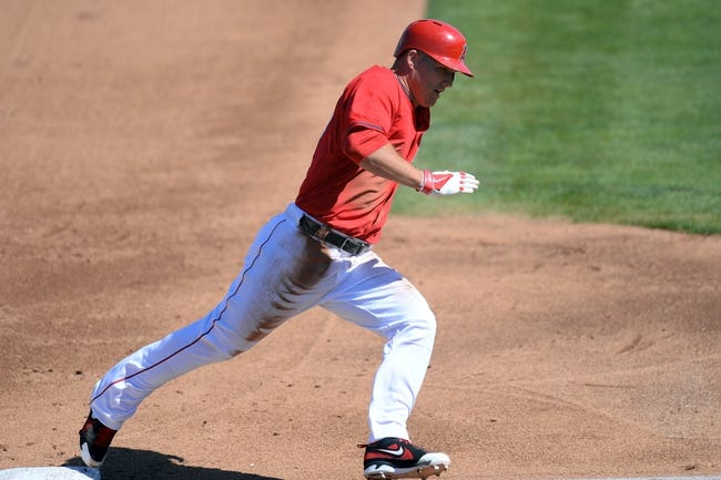 Mar 11, 2014; Tempe, AZ, USA; Los Angeles Angels center fielder Mike Trout (27) rounds third base and scores a run against the Seattle Mariners at Tempe Diablo Stadium. Mandatory Credit: Joe Camporeale-USA TODAY Sports