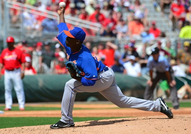 Mar 11, 2014; Jupiter, FL, USA; New York Mets relief pitcher Rafael Montero (50) delivers a pitch against the St. Louis Cardinals at Roger Dean Stadium. The Mets defeated the Cardinals 9-8. Mandatory Credit: Scott Rovak-USA TODAY Sports