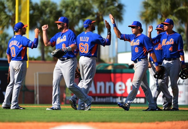 Mar 11, 2014; Jupiter, FL, USA; The New York Mets celebrate their victory over the St. Louis Cardinals at Roger Dean Stadium. The Mets defeated the Cardinals 9-8. Mandatory Credit: Scott Rovak-USA TODAY Sports