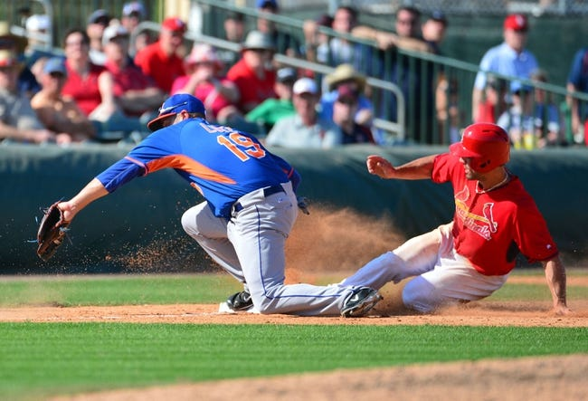 Mar 11, 2014; Jupiter, FL, USA; St. Louis Cardinals center fielder Randal Grichuk (88) is forced out by New York Mets third baseman Zach Lutz (19) at Roger Dean Stadium. The play was challenged by Cardinals manager Mike Matheny (not pictured) and was ruled inconclusive and therefore stood as called. The Mets defeated the Cardinals 9-8. Mandatory Credit: Scott Rovak-USA TODAY Sports