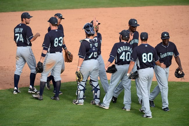 Mar 11, 2014; Tempe, AZ, USA; Seattle Mariners players celebrate after defeating the Los Angeles Angels at Tempe Diablo Stadium. The Mariners won 10-6. Mandatory Credit: Joe Camporeale-USA TODAY Sports