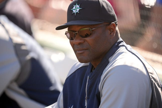 Mar 11, 2014; Tempe, AZ, USA; Seattle Mariners manager Lloyd McClendon (23) looks on against the Los Angeles Angels at Tempe Diablo Stadium. Mandatory Credit: Joe Camporeale-USA TODAY Sports