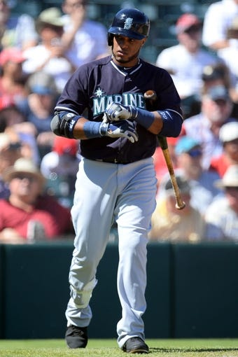 Mar 11, 2014; Tempe, AZ, USA; Seattle Mariners second baseman Robinson Cano (22) walks to the batter's box against the Los Angeles Angels at Tempe Diablo Stadium. Mandatory Credit: Joe Camporeale-USA TODAY Sports