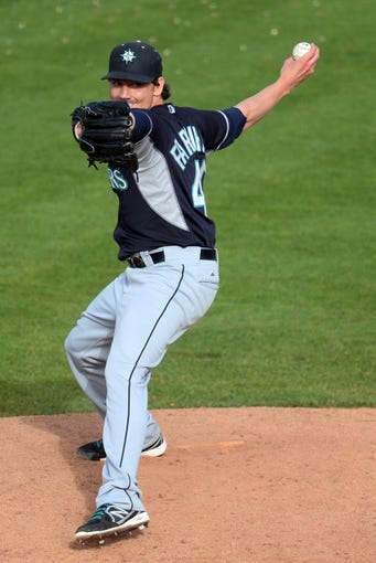 Mar 11, 2014; Tempe, AZ, USA; Seattle Mariners relief pitcher Danny Farquhar (40) pitches in the ninth inning against the Los Angeles Angels at Tempe Diablo Stadium. The Mariners won 10-6. Mandatory Credit: Joe Camporeale-USA TODAY Sports