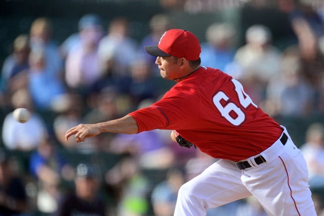 Mar 11, 2014; Tempe, AZ, USA; Los Angeles Angels relief pitcher Clay Rapada (64) pitches in the ninth inning against the Seattle Mariners at Tempe Diablo Stadium. Mandatory Credit: Joe Camporeale-USA TODAY Sports