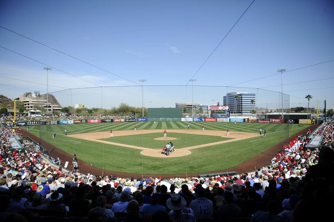 Mar 11, 2014; Tempe, AZ, USA; A general view of game action between the Los Angeles Angels and the Seattle Mariners at Tempe Diablo Stadium. The Mariners won 10-6. Mandatory Credit: Joe Camporeale-USA TODAY Sports