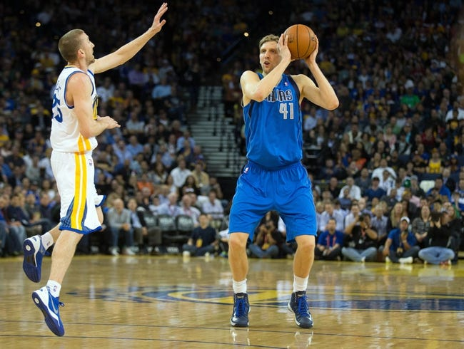 Mar 11, 2014; Oakland, CA, USA; Dallas Mavericks forward Dirk Nowitzki (41) controls the ball against Golden State Warriors guard Steve Blake (25) during the second quarter at Oracle Arena. Mandatory Credit: Kelley L Cox-USA TODAY Sports
