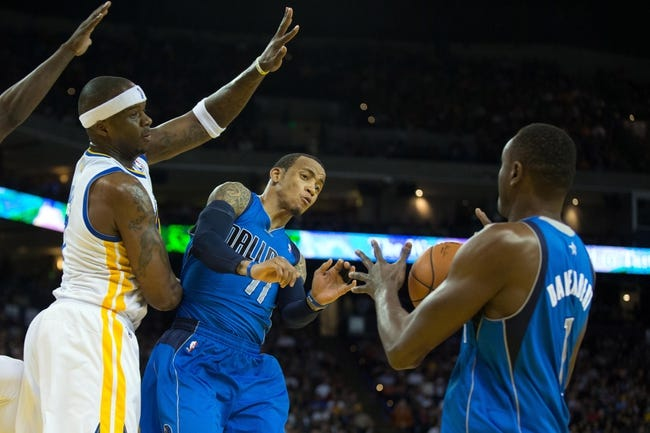 Mar 11, 2014; Oakland, CA, USA; Dallas Mavericks guard Monta Ellis (11) passes out the ball to center Samuel Dalembert (1) against Golden State Warriors center Jermaine O'Neal (7) during the second quarter at Oracle Arena. Mandatory Credit: Kelley L Cox-USA TODAY Sports