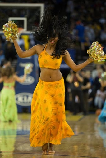 Mar 11, 2014; Oakland, CA, USA; Golden State Warriors dancer performs during a timeout against the Dallas Mavericks during the second quarter at Oracle Arena. Mandatory Credit: Kelley L Cox-USA TODAY Sports