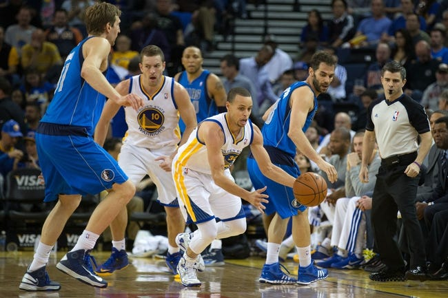 Mar 11, 2014; Oakland, CA, USA; Golden State Warriors guard Stephen Curry (30) steals the ball against Dallas Mavericks guard Jose Calderon (8) during the third quarter at Oracle Arena. The Golden State Warriors defeated the Dallas Mavericks 108-85. Mandatory Credit: Kelley L Cox-USA TODAY Sports