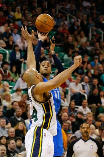 Mar 12, 2014; Salt Lake City, UT, USA; Dallas Mavericks guard Monta Ellis (11) shoots over Utah Jazz forward Richard Jefferson (24) during the second quarter at EnergySolutions Arena. Mandatory Credit: Chris Nicoll-USA TODAY Sports